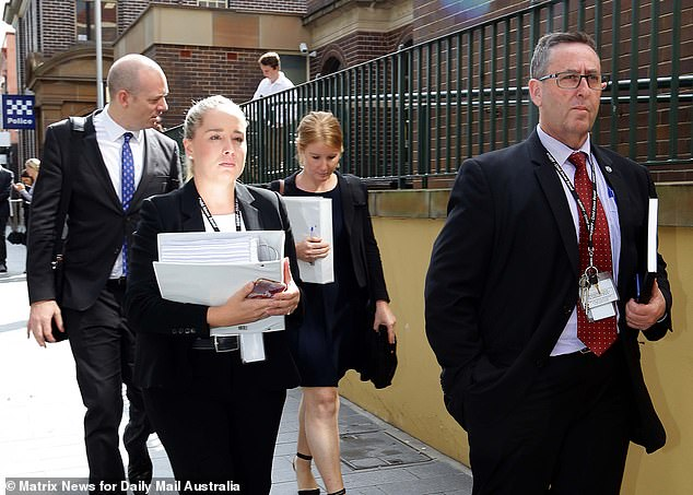 Detectives from the NSW Police Child Abuse and Sex Crimes squad arrive at Manly Local Court on Wednesday