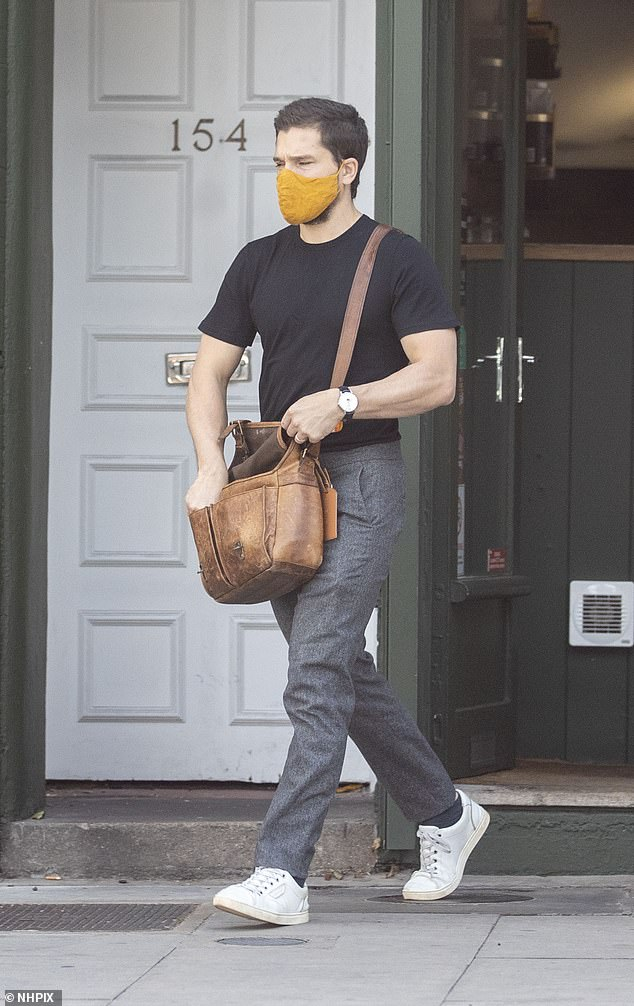 Stop off: He nipped into a shop for something, donning a mustard face-mask to abide by the COVID-19 rules in force currently in stores