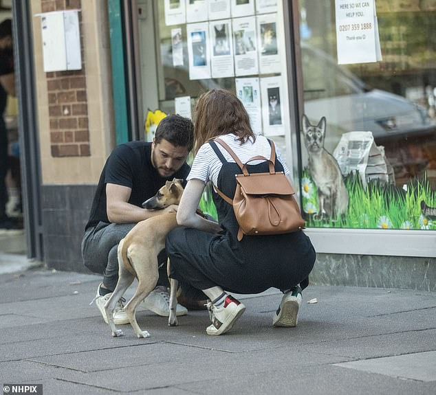 Couple: He was seen out and about with his wife Rose Leslie, 33, and their dog, as they took a stroll in North London