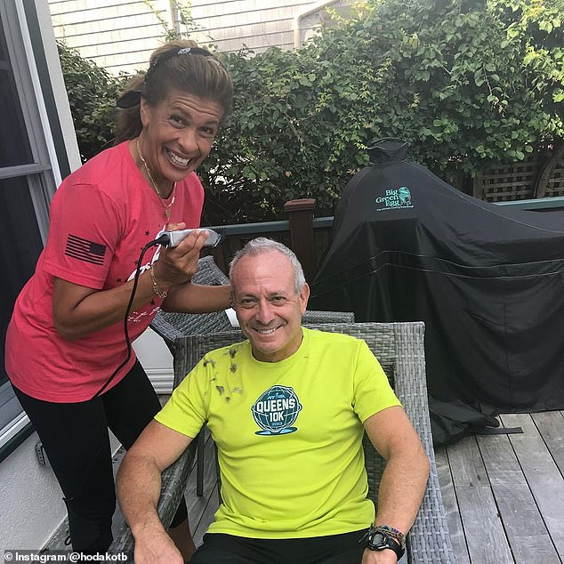 Having fun: Hoda ended the day by giving her fiancé an at-home haircut. In the snapshot that she shared, she can be seen buzzing Joel